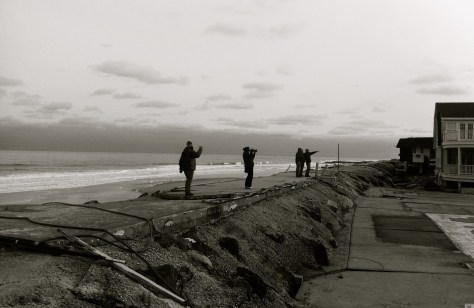 People walk the sea wall by Donovan's Reef in Sea Bright after Sandy, checking out what's left of the iconic spot. Photo/Elaine Van Develde