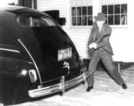 Henry Ford swinging an axe at his 1941 car to demonstrate the toughness of the plastic trunk door made of soybean and hemp. (From the collections of Henry Ford Museum & Greenfield Village.)