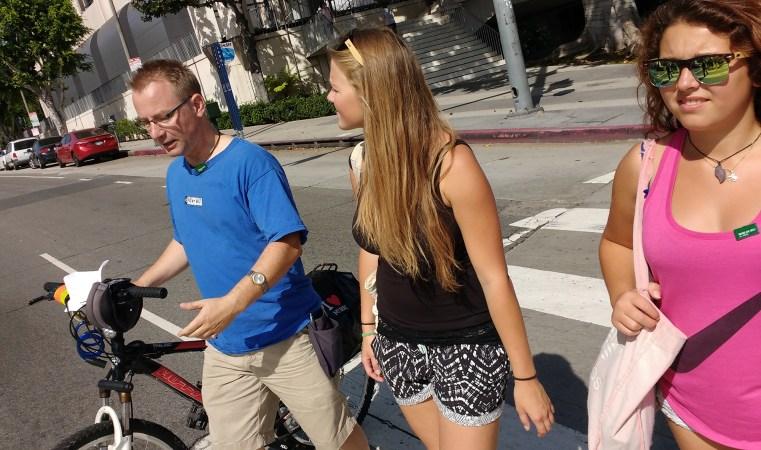 Ben, Stefanie and Zeinab walk across 1st street in Downtown Los Angeles