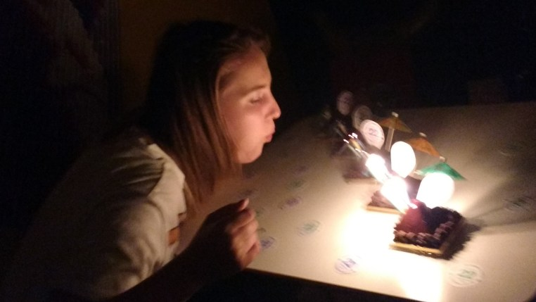 Justa blows out her birthday candles!