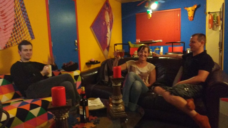3 people sitting at couches