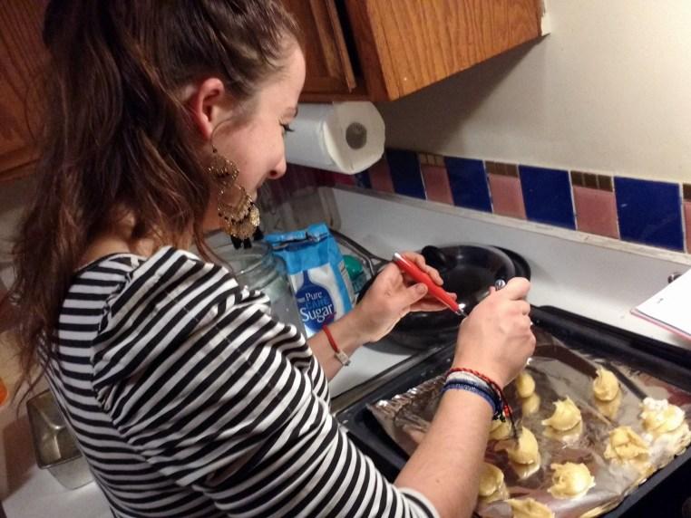 Terézia forming cookies on an oven sheet