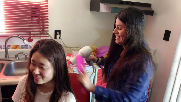 Johanna Acero blow drying Soojeen Heo's hair