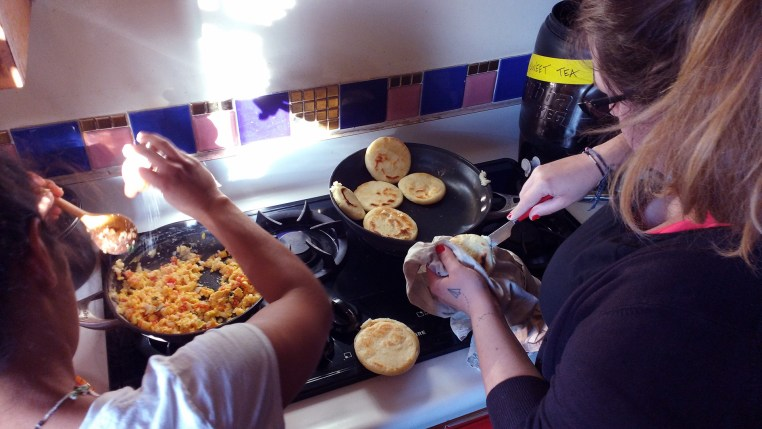 Eleo and Cecile working over the stove
