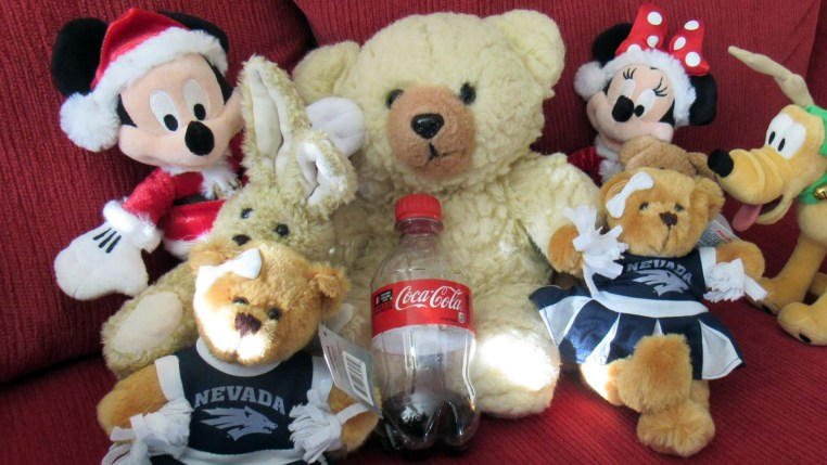 Ambyr Noelle with other plush animals including UNR Cheerleader bears