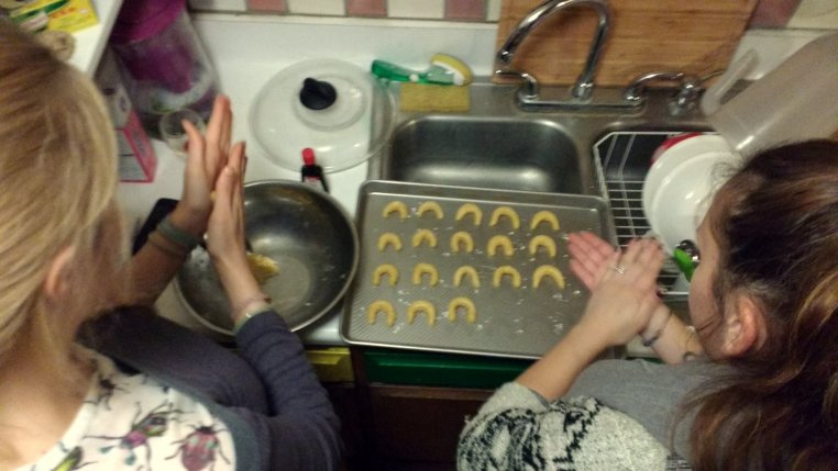 Bianca and Maya in the kitchen making cookies