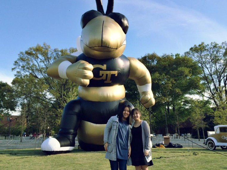 Blair and a friend standing in front of a gigantic, inflatable Georgia Tech character