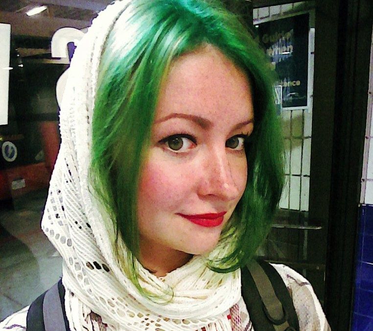 Yulia with green front sections of hair and  a scarf