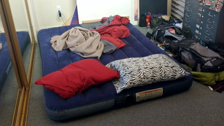 photo of an air mattress on the ground in a bedroom