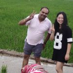 Kamal & friend in a field
