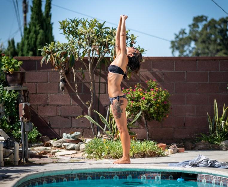 Chiara Guatelli does yoga on the veranda at the Runaway University aquatic center