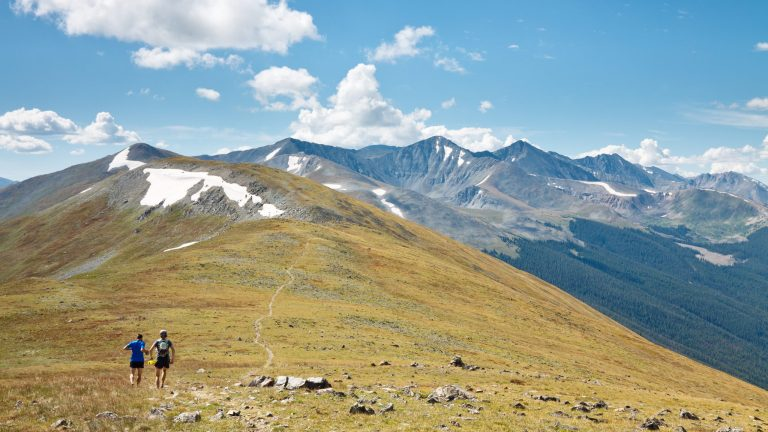 Trail runners in the mountains ultra running alpine colorado