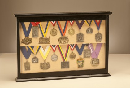 """Loved It"" display case with medals."