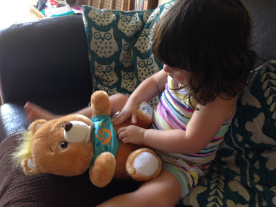 girl playing with Freddy bear