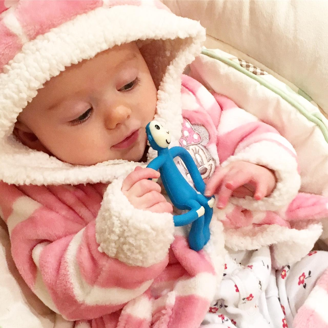 baby with matchstick monkey