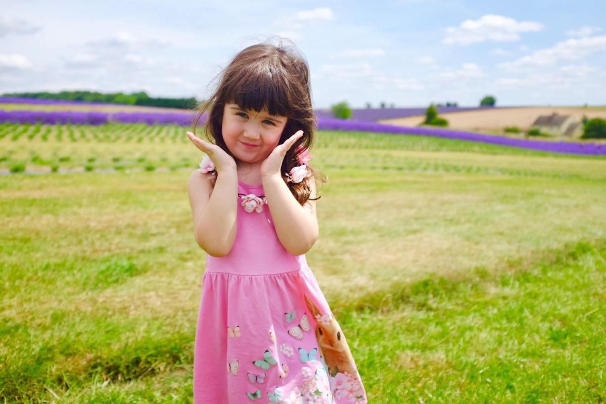 little girl in a field - gender neutral too far