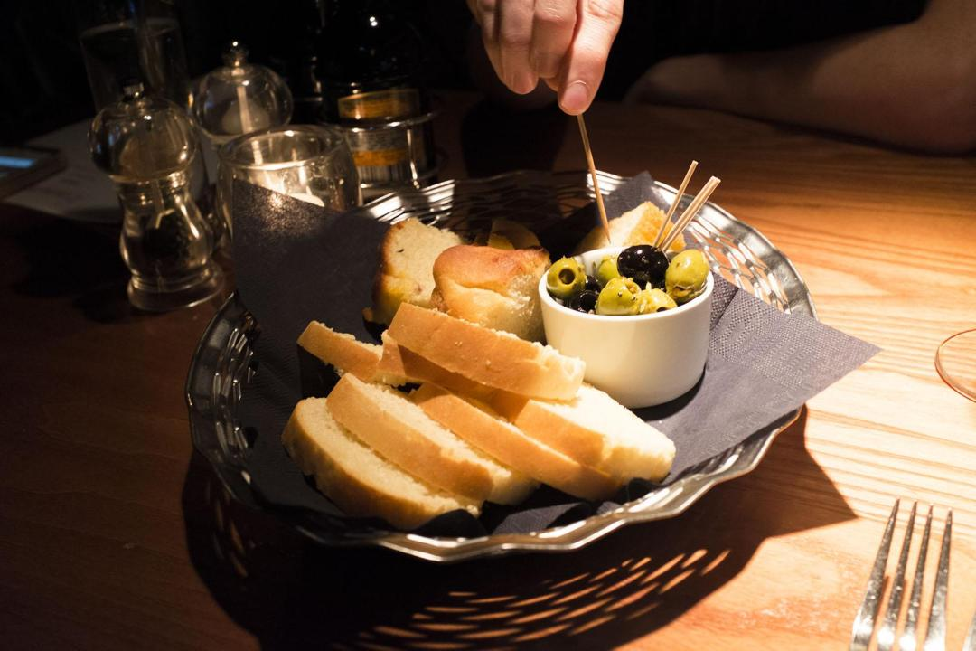 olives and bread in cucina rustica