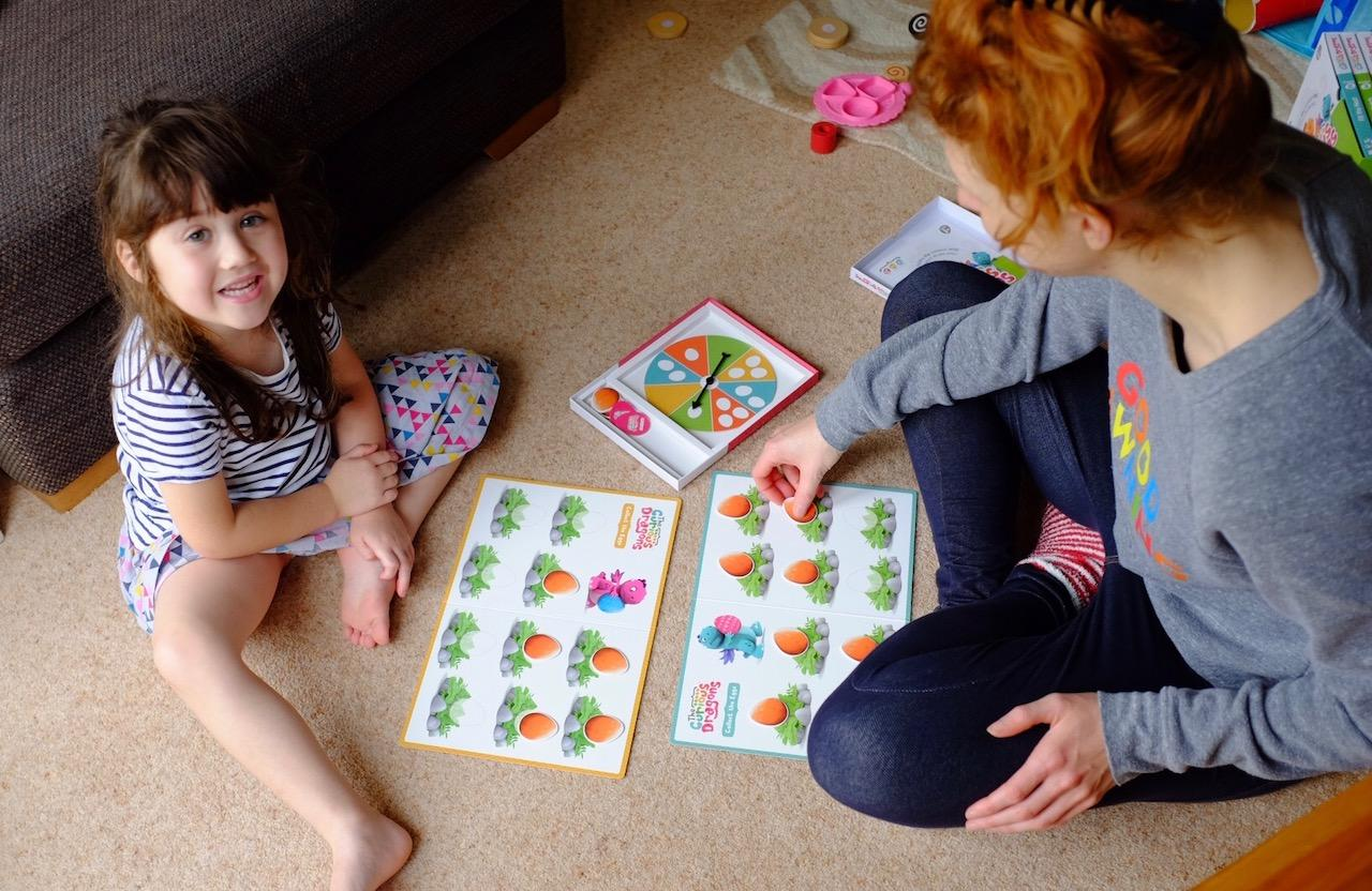 mum and daughter playing curious dragions maths game