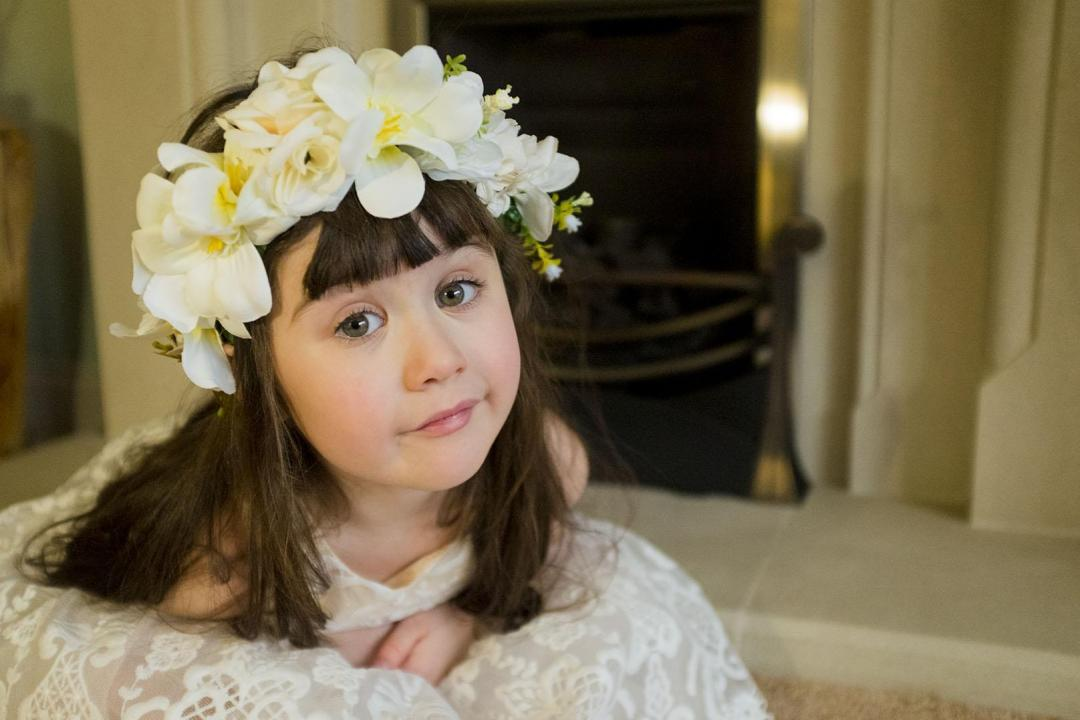 dark haired girl in a flower crown from roco clothes