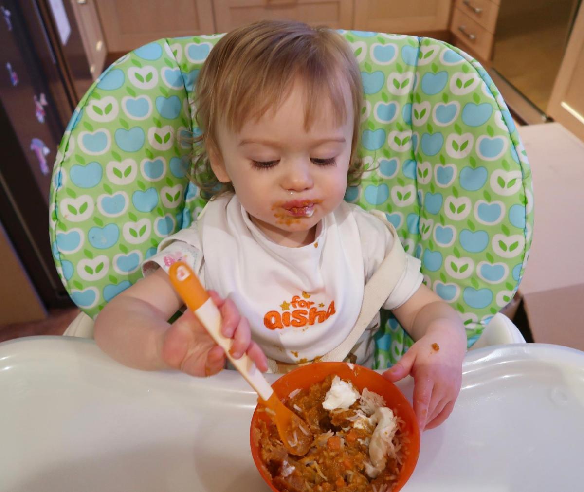 baby feeding themselves