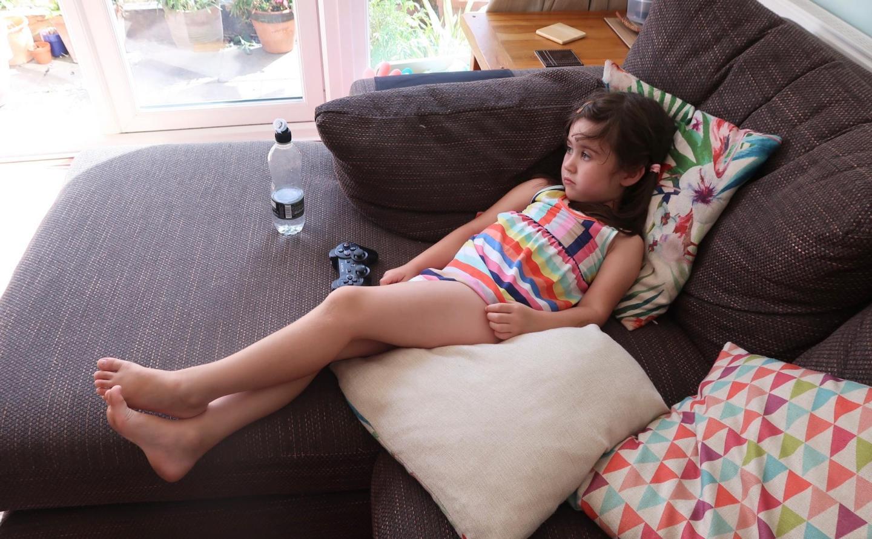 girl lying on sofa