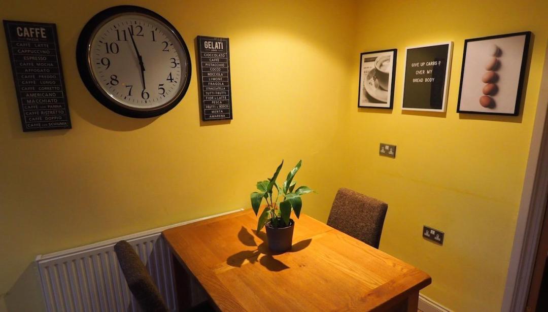 kitchen with desenio prints hung