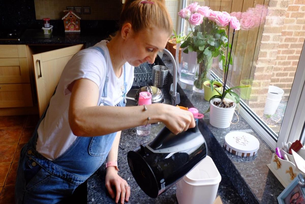 pouring boiling water in Hansell yoghurt maker
