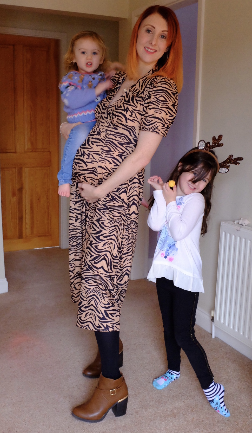 girl in maternity long animal print dress
