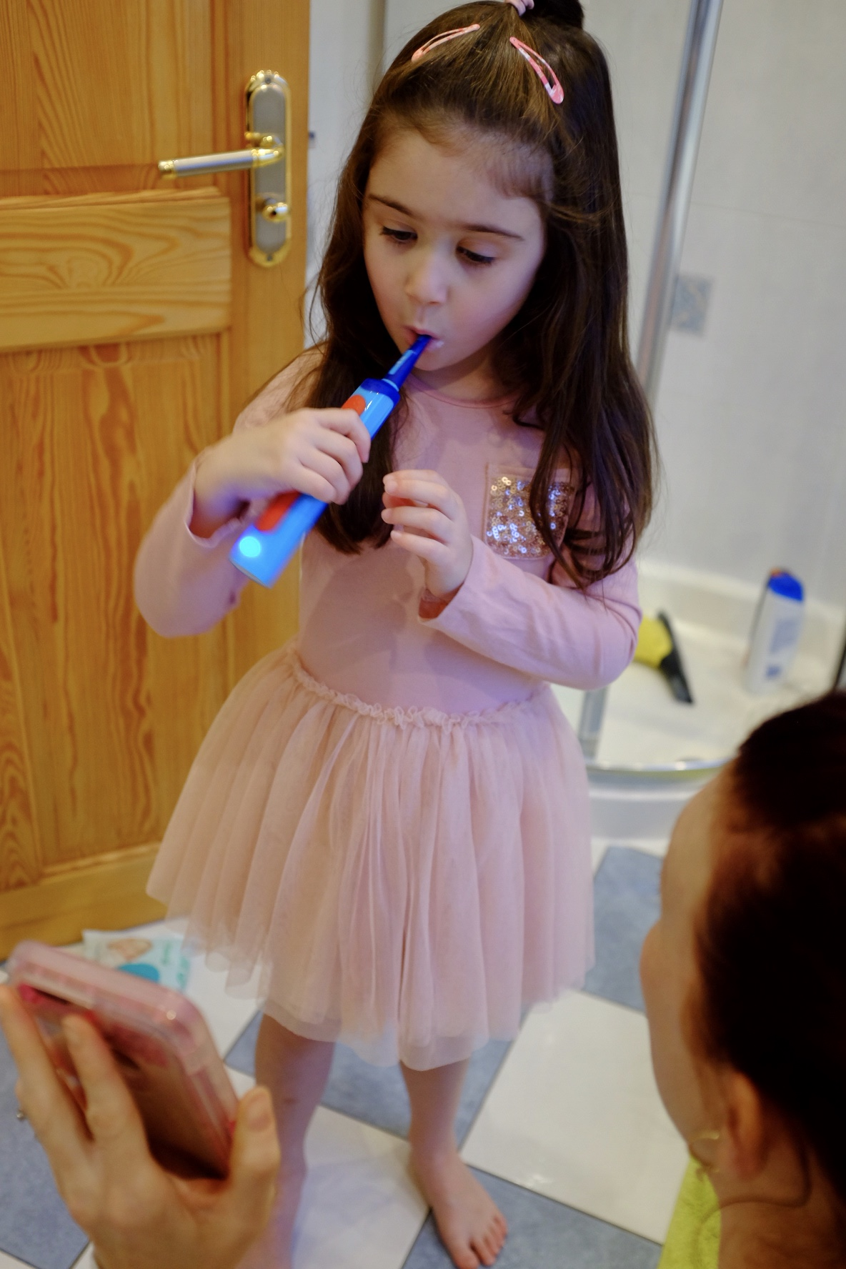 girl brushing her teeth with Playbrush