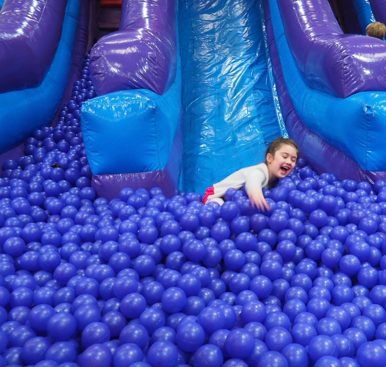 Girl coming down medium slide Inflatanation Birmingham