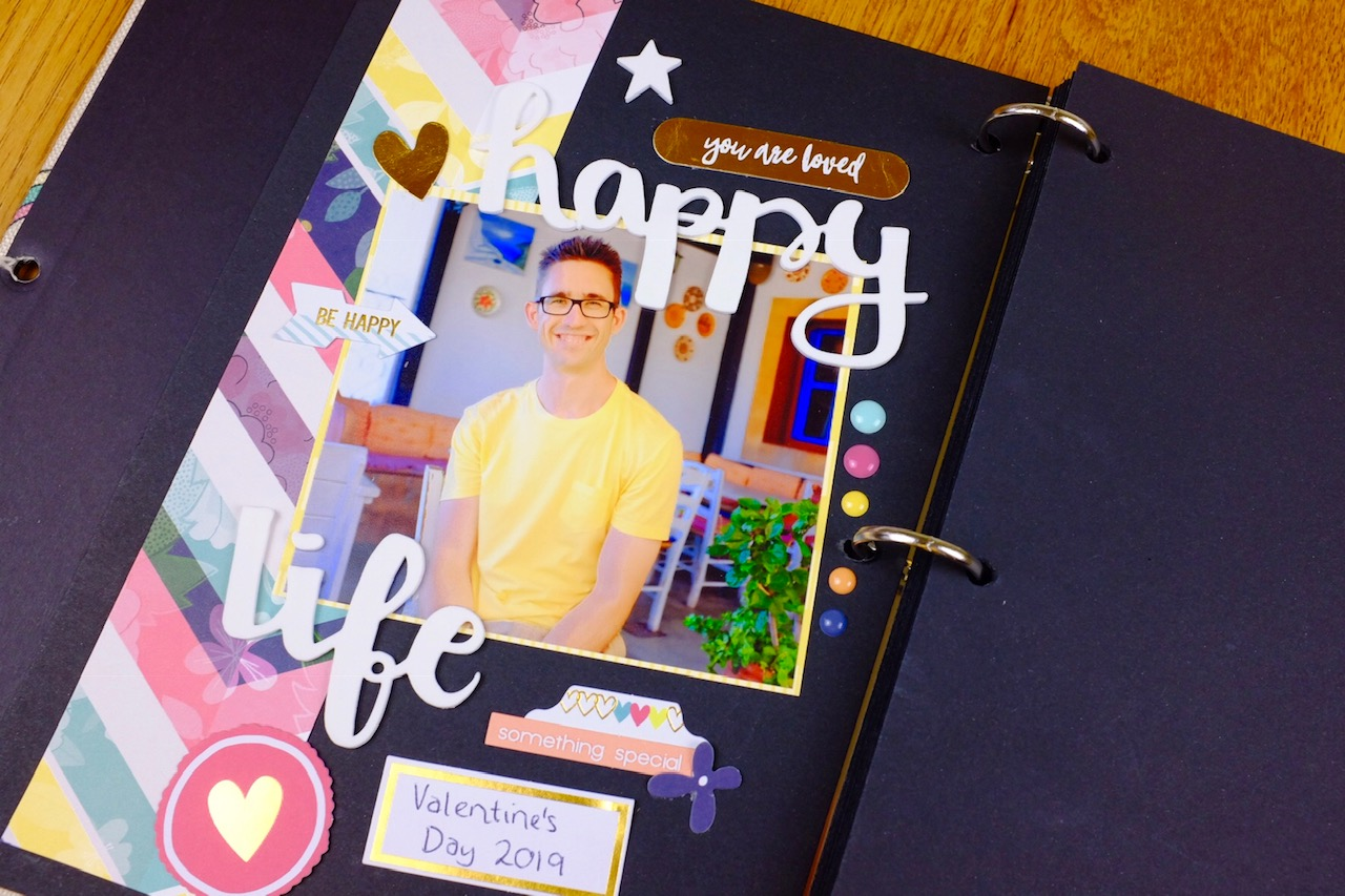 Completed scrapbook page using a Veesun scrapbook book