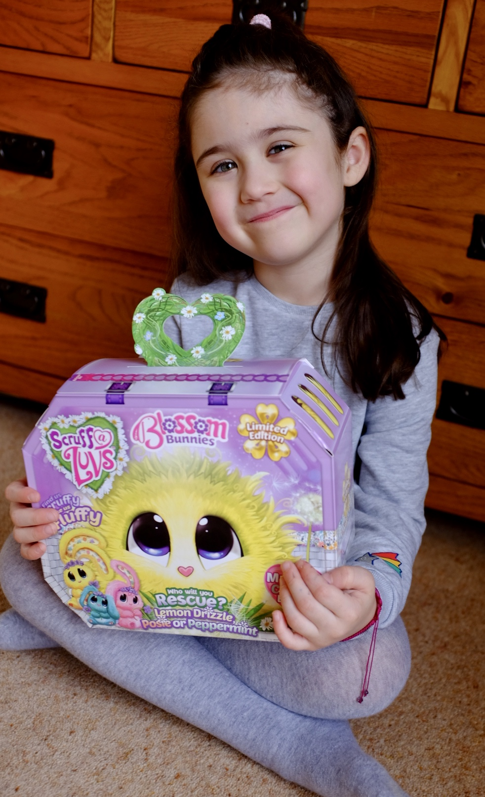 girl with Blossom Bunnies Scruff a Luvs the box