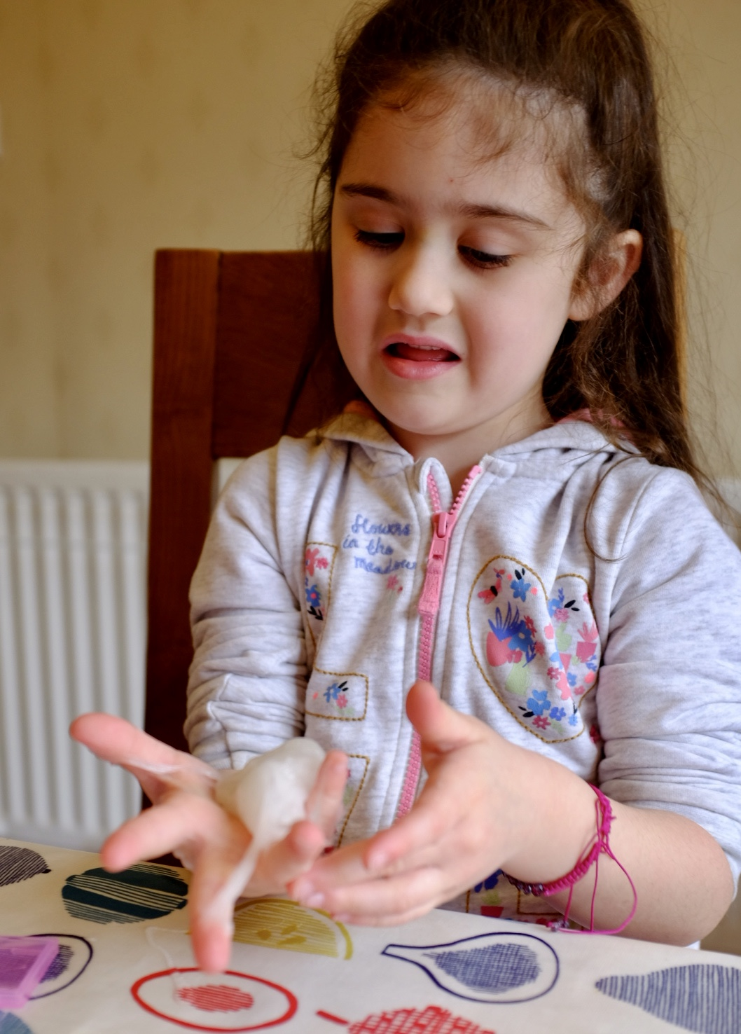 girl playing with glam goo deluxe kit slime
