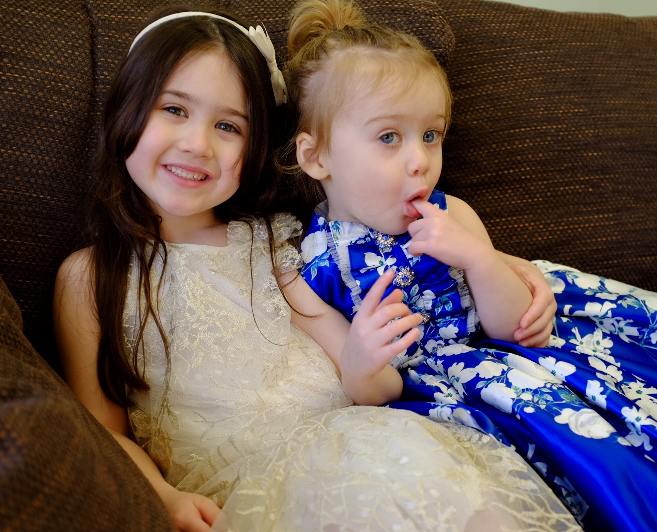 sisters in David Charles spring/summer collection dresses