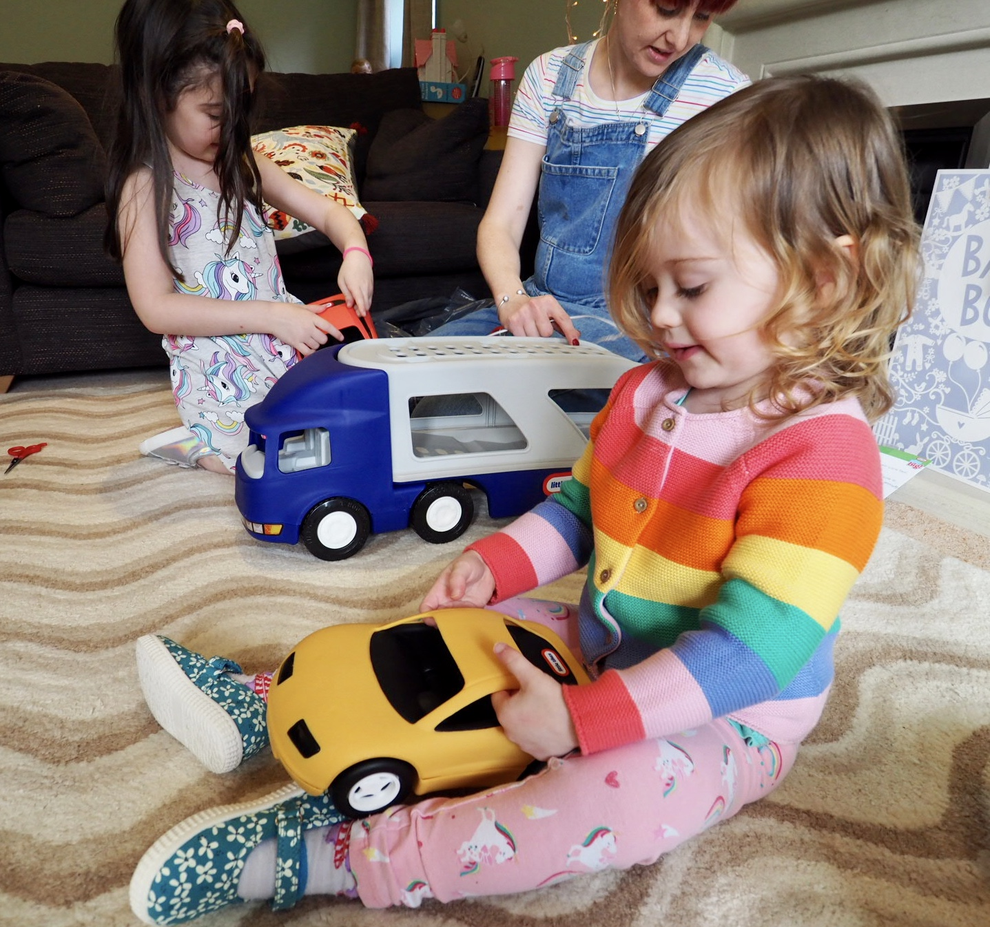 girl playing with the little tikes big car carrier