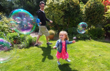 girl playing with mega bubble blaster