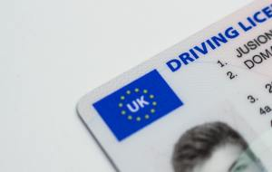 A driving license is a good form of I.D. Alternatively, you can use a passport, student card or a copy of your birth certificate.