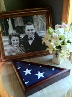 Grandma & Grandpa Harvey (Marie & Capt. Harlon Harvey, USNR, WWII veteran) and the flag from grandpa's funeral. One of my favorite photos of my grandparents, taken at a friend's wedding when they were very young.