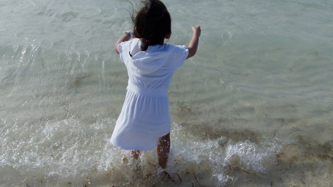 Our daughter enjoying the waves at Castaway Cay, Bahamas