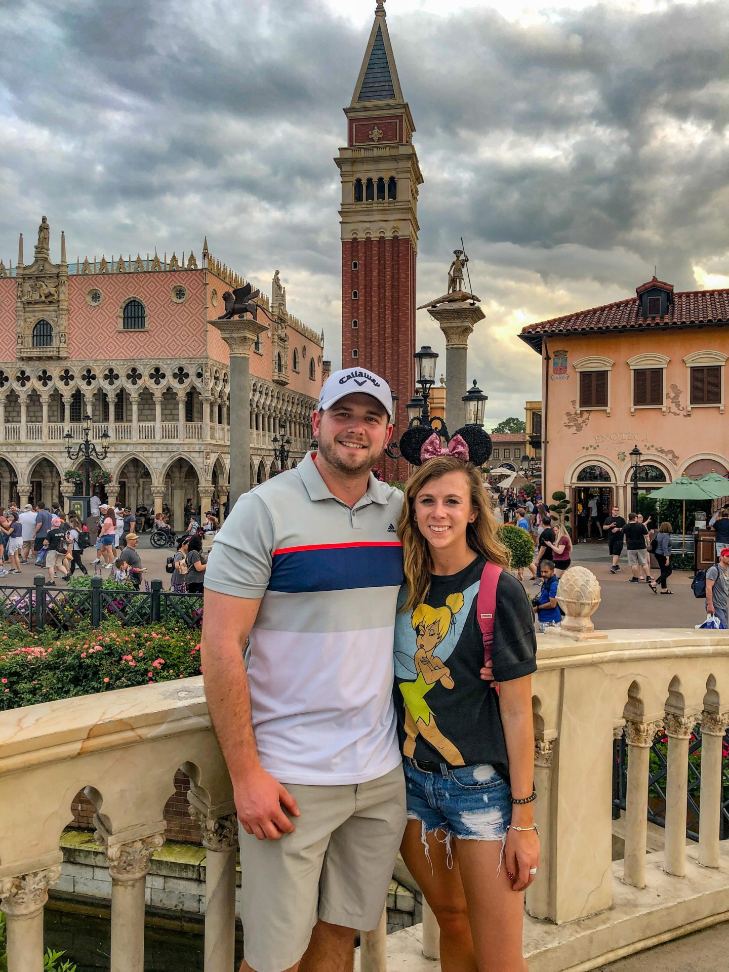 Adult Guide to Disney World Theme Parks Broken Down by Park | Running in Heels | Couple stands in front of Italy in Epcot at Disney World.