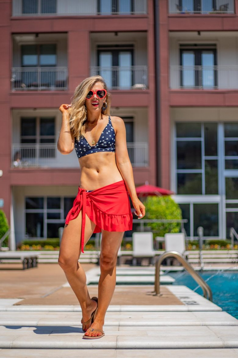 Cute 4th of July outfits featured by top US fashion blog, Running in Heels: image of a woman wearing a j Crew factory star French bikini, Target heart shaped sunglasses, Hair Mari flip flops and J Bubs earrings.