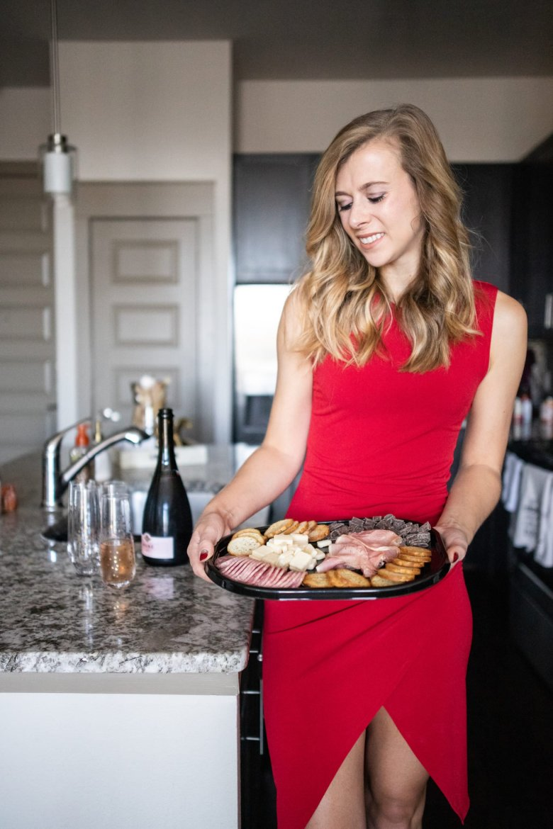 Hosting Tips for the Best Friends Holiday Party, try a Hillshire Farm snacking platter, sparkling wine, and wear a festive holiday red dress. Feature by top US fashion and lifestyle blogger Running in Heels