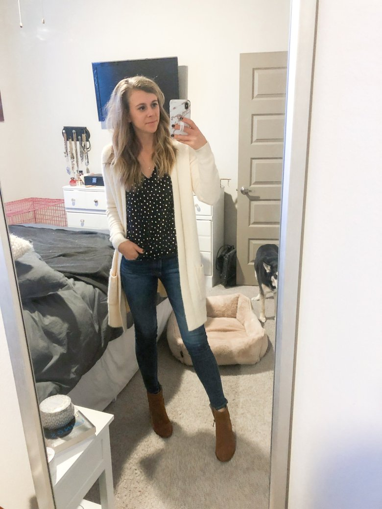 Cream colored fluffy cardigan over a navy chiffon top paired with jeans and brown suede booties by Top US fashion and lifestyle blogger Running in Heels