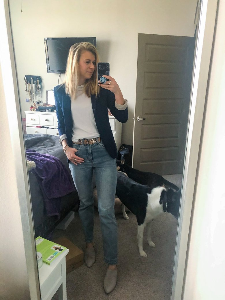 Top US fashion and lifestyle blogger wears white t-shirt and jersey navy blazer, Express straight leg jeans, snakeskinbelt, and DSW Journee mules