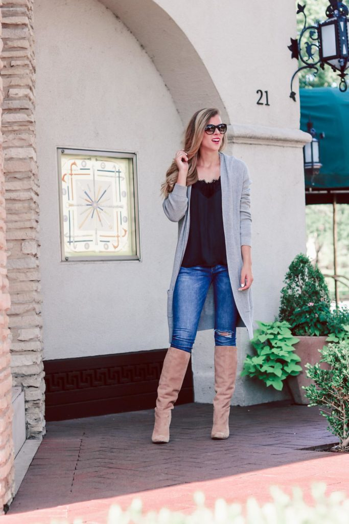 Slouch suede tall boots, the new boot trend, featured by top US fashion blog, Running in Heels: image of a woman wearing Caprice Knee-High Boot SAM EDELMAN