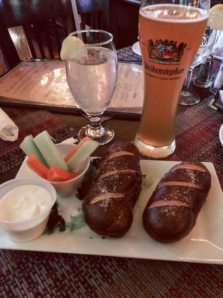 Where to eat in NYC featured by top US travel blog, Running in Heels: image of The Keg Room, beer brie with pretzle rolls and beer