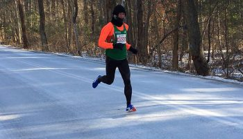 Japan's Yuki Kawauchi breaks marathon record in bone-chilling conditions