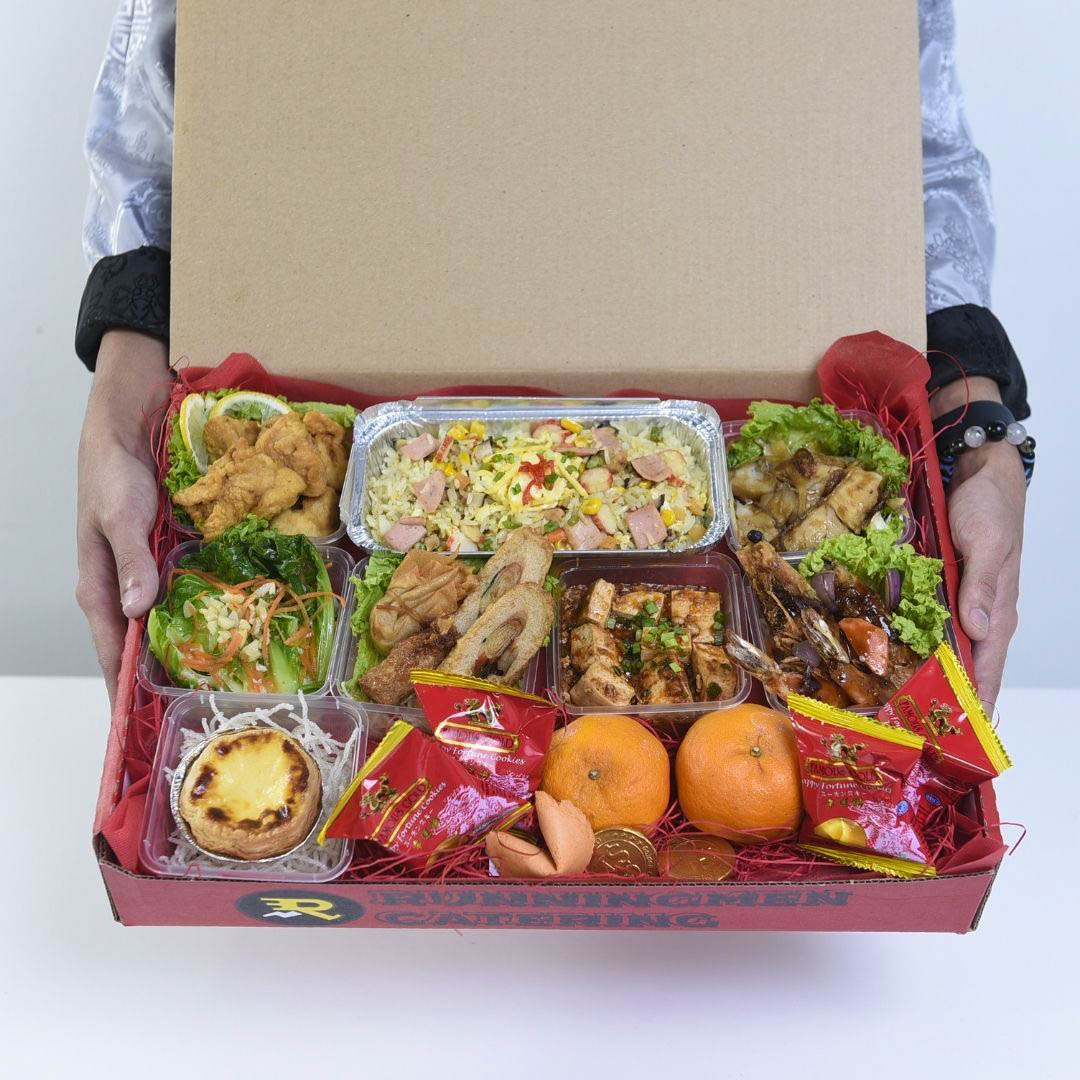 runningmen catering foodie box for corporate with man holding virtual party box 2
