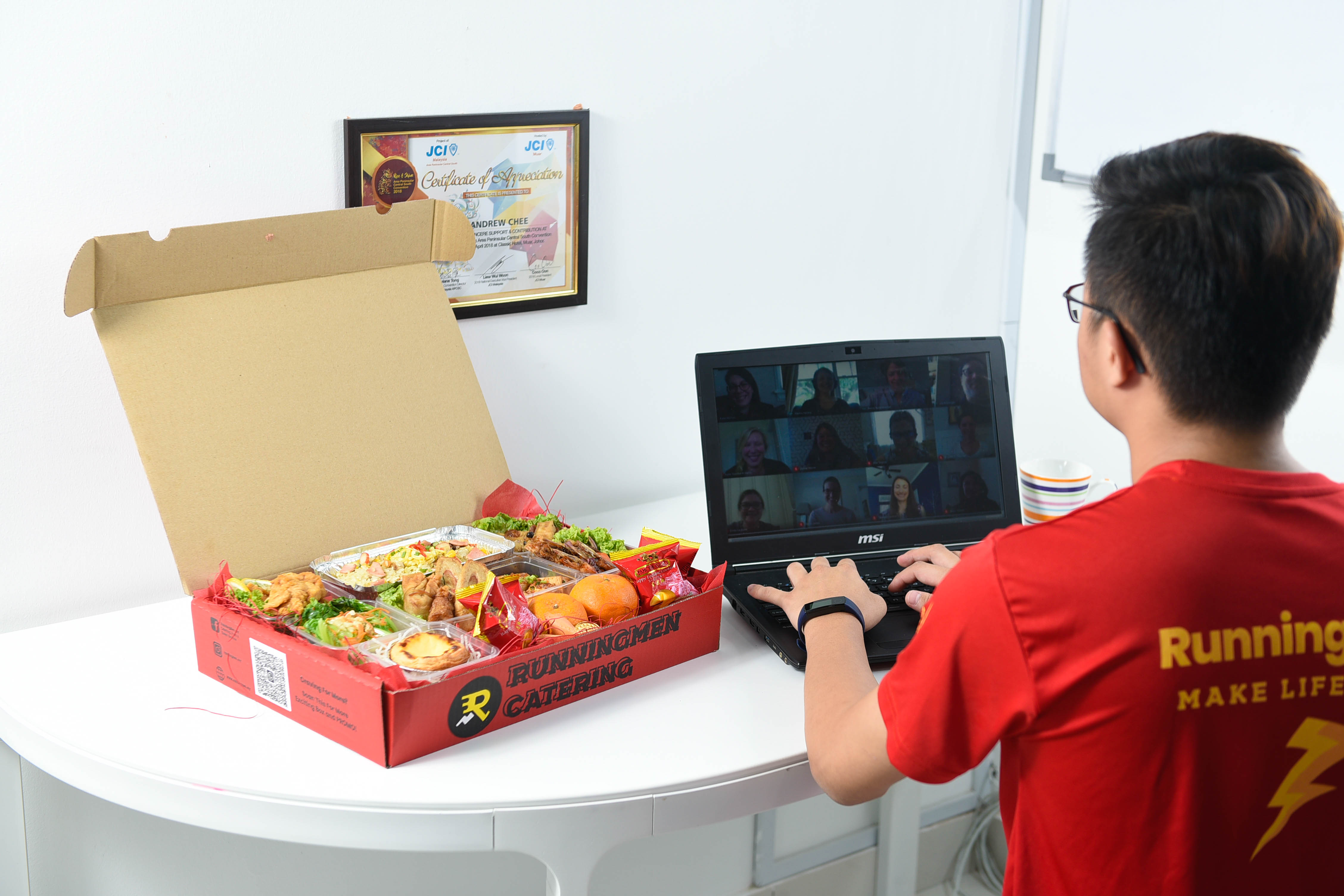 runningmen catering foodie box for corporate with man having virtual party