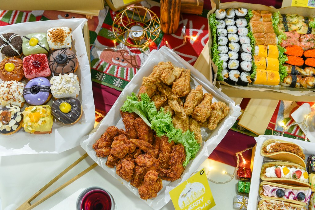 runningmen catering foodie box with korean fried chicken, assorted doughnut, japanese sushi box, eclair, pancake and beautiful food decoration